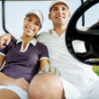 Stock Photo: Couple enjoying a game of golf