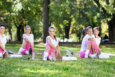 Girls smiling and stretching — Stock Photo