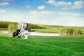 Paar golfen — Stockfoto