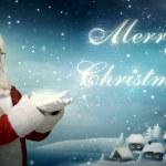 Santa Claus blowing snow 'Merry Christmas' — Stock Photo #16942923