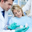 Dentist with patient and dental mold — Stock Photo
