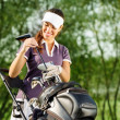 Young brunette woman with golf equipment — Stock Photo