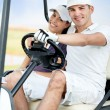 Couple enjoying golf course — Stock Photo