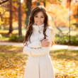 Stock Photo: Adorable woman in autumn park