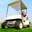 Royalty-Free Stock Photo: Woman in golf cart