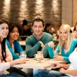 Stock Photo: Group of teenagers in cafe