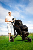 Handsome young golfer — Stock Photo