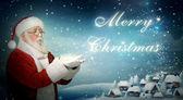Weihnachtsmann weht schnee 'merry christmas' — Stockfoto