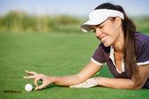 Woman pushing golf ball — Stock Photo