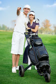 Young sportive couple playing golf — Stock Photo