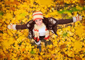 Happy woman playing in autumn — Stock Photo