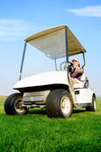 Woman in golf cart — Stock Photo