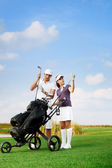 Couple playing golf at the club — Stock Photo
