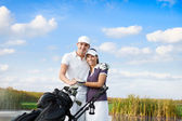 Golf couple with golf bag — Stock Photo