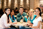 Group of teenagers in cafe — Stock Photo