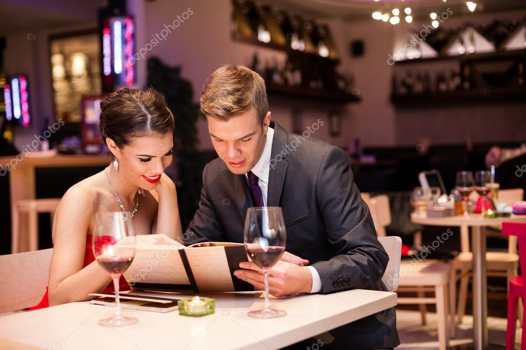 Smiling couple reading menu  and choosing meal  — Stock Photo #16944065