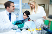 Dentist showing x-ray — Stock Photo