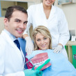 Dentist teaching to brush teeth — Stock Photo