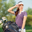 Woman with golf equipment — Stock Photo