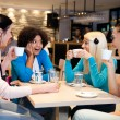 Friends enjoying in a cafe — Stock Photo