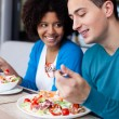 Stock Photo: Lovely interracial couple having lunch