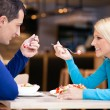 Beautiful couple on lunch - Stock Photo