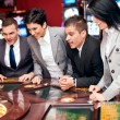 Excited group in casino — Stock Photo