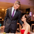 Affectionate couple in a restaurant - Foto Stock