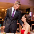 Affectionate couple in a restaurant - Stock Photo