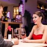 Couple enjoying in a restaurant — Stock Photo