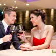 Happy couple at restaurant table toasting — Stock Photo #20182461