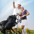 Young couple with golf bag — Stock Photo