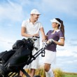 Couple playing golf on a sunny day — Stock Photo