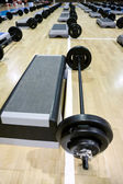 Lifting weights and steppers — Stock Photo