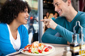 Cheerful couple in restaurant — Stock Photo