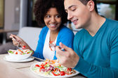 Lovely interracial couple having lunch — Foto de Stock