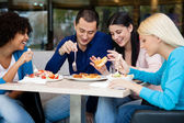 Young having lunch in restaurant — Stock Photo