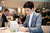 Businesswoman and tablet — Stock Photo