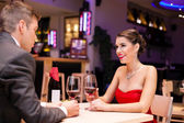 Couple enjoying in a restaurant — Stock Photo