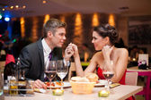 Couple flirting at restaurant — Stok fotoğraf