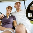 Young couple on golf - Stock Photo
