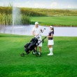 Young couple on golf course — Photo