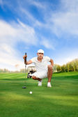 Golfer on golf course — Stock Photo