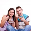 Happy young couple sitting on the floor — Stock Photo #2450483