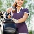 Woman with golf equipment - Stock Photo