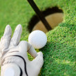 Golf ball on green grass next hole — Foto Stock
