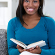 Woman in enjoying reading book — Stock Photo #24888755