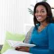 African woman reading book — Stock Photo