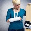 Unhappy snowboarder with  broken arm - Stock Photo