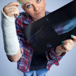 Woman with x-ray of her broken arm - Stock Photo